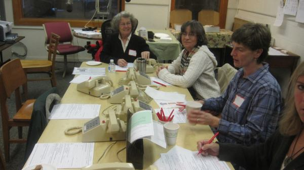 Volunteers help answer phones during a pledge drive at New England Public Radio